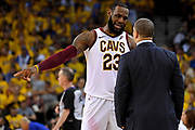 June 3, 2018; Oakland, CA, USA; Cleveland Cavaliers forward LeBron James (23) talks to Cleveland Cavaliers head coach Tyronn Lue during the fourth quarter against the Golden State Warriors in game two of the 2018 NBA Finals at Oracle Arena.