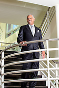 portraits,CEO of Carnival Cruises standing in lobby of home office