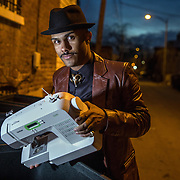 "WASHINGTON,DC - MAR19: Justin Cannon, the founder of The Quitters Club, ""throws away"" a sewing machine in Washington, DC, March 19, 2015. He's quit efforts at film making, graphic design, fashion, and music. The tagline of the Quitters Club is, ""Let's give up on our dreams together."" (Photo by Evelyn Hockstein/For The Washington Post)"