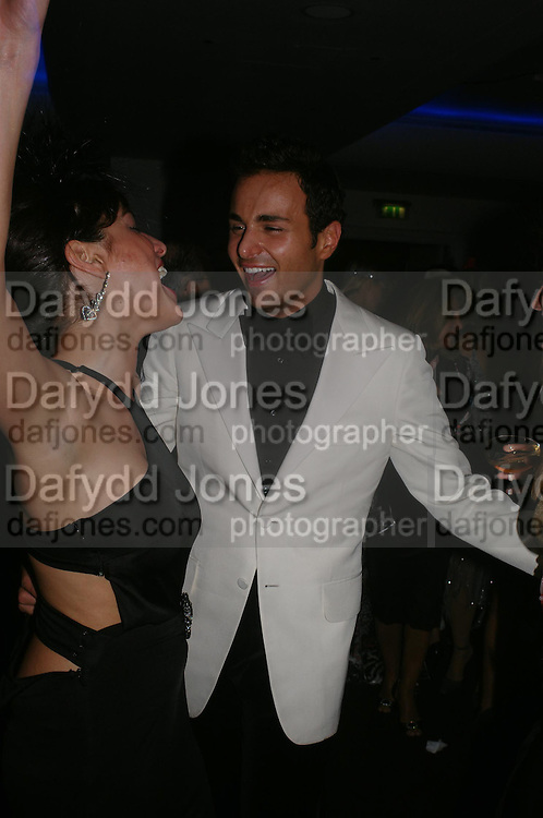 Lulu Stoffer and Marcus Ketty. Andy & Patti Wong's Chinese New Year party to celebrate the year of the Rooster held at the Great Eastern Hotel, Liverpool Street, London.29th January 2005. The theme was a night of hedonism in 1920's Shanghai. . ONE TIME USE ONLY - DO NOT ARCHIVE  © Copyright Photograph by Dafydd Jones 66 Stockwell Park Rd. London SW9 0DA Tel 020 7733 0108 www.dafjones.com
