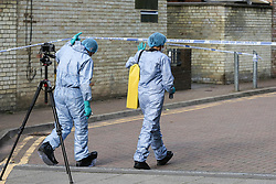 © Licensed to London News Pictures. 11/08/2019. London, UK. Forensic officers at a crime scene on a building estate of Seven Sisters Road junction with St Ann's Road in Tottenham, north London, where a 25 year old man was found with multiple stab wounds on Bus 67 at the Seven Sister Road/Kerswell Close bus stop, just before 2.20pm. According to the Met police, the victim is fighting for his life in hospital. Photo credit: Dinendra Haria/LNP