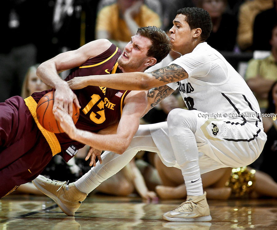 SHOT 2/19/14 11:53:02 PM - Colorado's Dustin Thomas #13 and Arizona State's Jordan Bachynski #13 battle for the ball while falling to the floor during their regular season Pac-12 basketball game at the Coors Events Center in Boulder, Co. Colorado won the game 61-52.<br /> (Photo by Marc Piscotty / &copy; 2014)