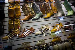 Boots and tennis shoes made of ostrich leather are for sale in a market in Culiacan, Mexico.  Footwear made of exotic animal skins are very popular and are associated with Mexico's Narco Culture.