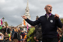 London, UK. 16 October, 2019. Donnachadh McCarthy of Extinction Rebellion asks Craig Bennett, CEO of Friends of the Earth, at a Right to Protest assembly in Trafalgar Square when campaigners from his organisation and Greenpeace will join climate activists from Extinction Rebellion in protesting on the streets.