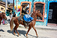 Ajijic, Jalisco State, Mexico. 13 February, 2018. Mardi Gras Festival and Parade, Mexican woman and child riding a horse. Peter Llewellyn/Alamy Live News