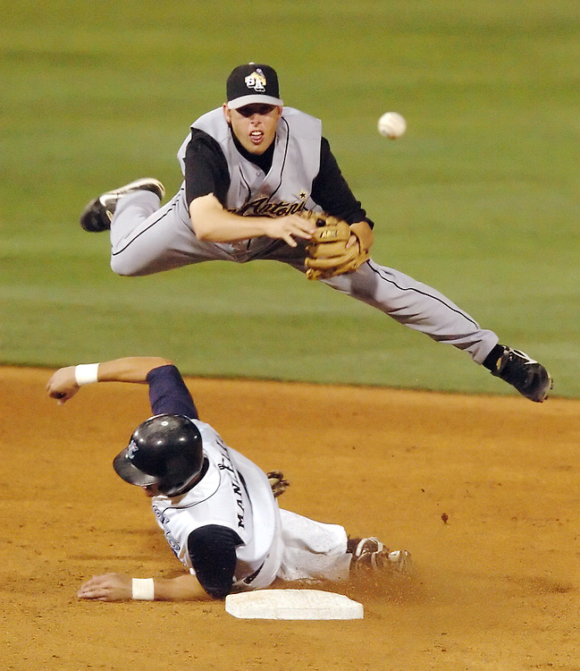 Michael Zamora/Caller-Times.San Antonio second baseman Brett Dowdy throws to first and leaps over Corpus Christi runner Tommy Manzella Tuesday, May 6, 2008 during the Hooks game against the Missions game at Whataburger Field in Corpus Christi.
