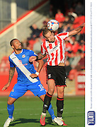 Ross Lafayette and Harry Pell during the Vanarama National League match between Cheltenham Town and Eastleigh at Whaddon Road, Cheltenham, England on 17 October 2015. Photo by Antony Thompson.