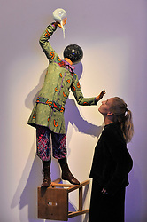 """© Licensed to London News Pictures. 12/10/2017. London, UK.  A staff member view """"Bad School Boy"""", 2014, by Yinka Shonibare (Est. GBP70-90k) at a preview of artworks for the """"Art for Grenfell"""" auction taking place at Sotheby's, New Bond Street, on 16 October.  Leading contemporary artists have agreed to donate works to the auction, the proceeds of which will be divided equally amongst the 158 surviving families of the Grenfell Tower fire by the Rugby Portobello Trust charity. Photo credit : Stephen Chung/LNP"""