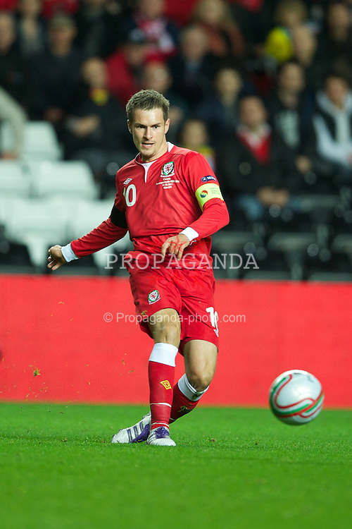 SWANSEA, WALES - Friday, October 7, 2011: Wales' captain Aaron Ramsey in action against Switzerland during the UEFA Euro 2012 Qualifying Group G match at the Liberty Stadium. (Pic by David Rawcliffe/Propaganda)