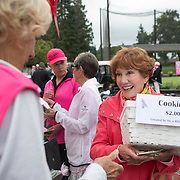 Penny Kirk sells cookies donated by Whim Studios during the annual Pink Ball Tournament in Charbonneau.<br /> Photo by Jaime Valdez