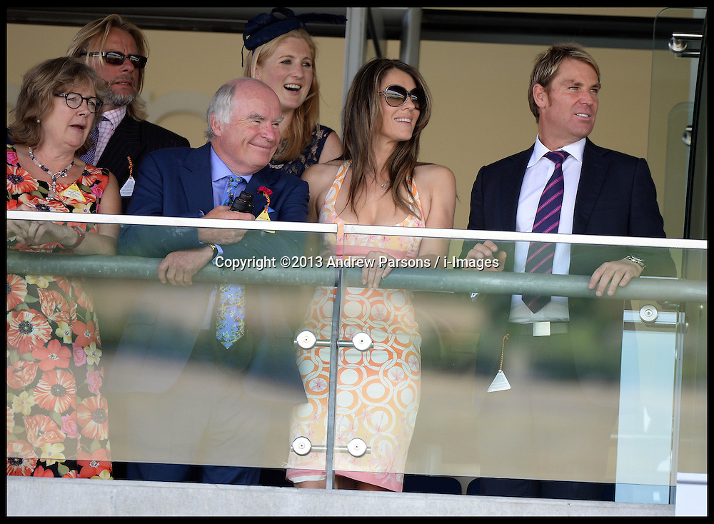 Liz Hurley with her partner Shane Warne watch the first race at Ascot Races, Ascot, United Kingdom<br /> Saturday, 27th July 2013<br /> Picture by Andrew Parsons / i-Images<br /> <br /> According to British Media - Australian cricketer Shane Warne and British model Liz Hurley are rumoured to have split after the couple stopped using social media to communicate.<br /> Picture by Andrew Parsons / i-Images<br /> Filed Tuesday 17 September, 2013.