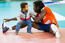 Mory Sidibe of ACH Volley  with his son after the volleyball match between ACH Volley and Generali Unterhaching (GER) in 1st Leg of Pool D of 2013 CEV Champions League on October 24, 2012 in Arena Stozice, Ljubljana, Slovenia. Unterhaching defeated ACH 3-2. (Photo By Vid Ponikvar / Sportida)