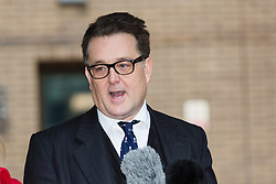 © Licensed to London News Pictures. 30/11/2015. London, UK. Andrew Fitch-Holland giving a statement before leaving Southwark Crown Court in London after the jury found him not guilty. The former New Zealand cricketer, Chris Cairns and his Barrister Andrew Fitch-Holland were both found not guilty of perjury and perverting the course of justice. Photo credit : Vickie Flores/LNP
