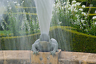 A frog shaped fountain in the White Garden at Les Jardin du Manoir D'Eyrignqac in Salignac, Dordogne, France