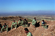 """Peshmerga (meaning """"those who face death"""" in Kurdish) fighters atop their mountain positions along the Shinirwe front line with Ansar al-Islam. Ansar al-Islam are Islamic extremists who have been linked with Al-Qaeda. They control a mountainous enclave along the border with Iran from where they carry out numerous attacks and assassination attempts in Iraqi Kurdistan...Halabja, Iraqi Kurdistan. 20/11/2002...Photo © J.B. Russell"""