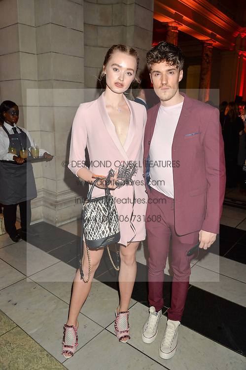 ZOEY KAY and JAMES STEWART at the Revlon Choose Love Masquerade Ball held at the V&A Museum, Cromwell Road, London on 21st July 2016.