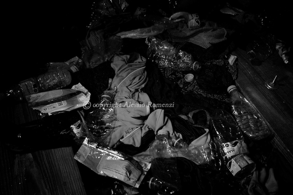 Italy, Southern Mediterranean sea: rubbish left on the bottom of the rubber boat which whom African migrants left Libya on August 31, 2015. Alessio Romenzi