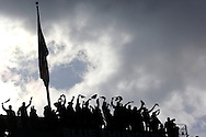 The 12th Man Flag is raised by the 1983 Seattle Seahawks playoff players  before the Tampa Bay Buccaneers against the Seattle Seahawks in an NFL football game Sunday, November 3, 2013 in Seattle, WA.  (AP Photo/Tom Hauck)