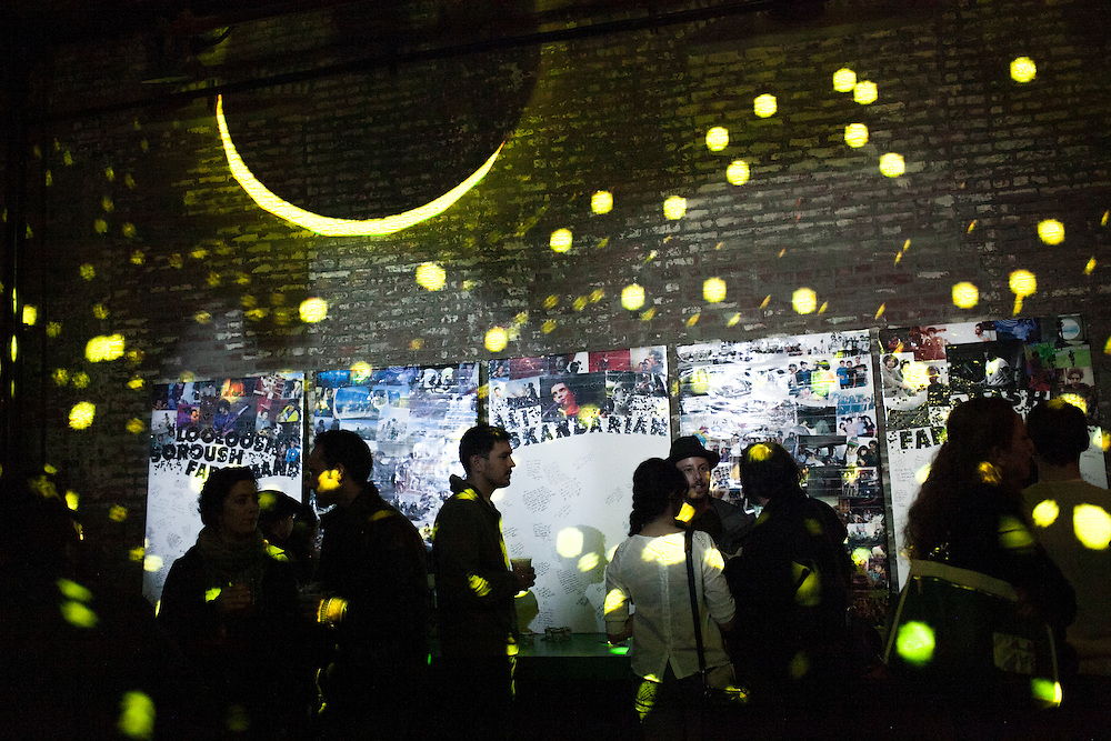 People stand in front of a memorial at a benefit concert for the Yellow Dogs, the band whose members were killed last week, at Brooklyn Bowl, 61 Wythe Avenue in the Williamsburg neighborhood of Brooklyn, NY on Monday, Nov. 18, 2013.<br /> <br /> Photograph by Andrew Hinderaker