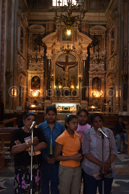 The Sri Lankan Catholics attend church of the Gesu Nuovo because there a priest professes their compatriot
