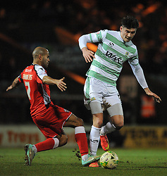 Yeovil Town's Kieffer Moore is tackled by Walsall's Adam Chambers - Photo mandatory by-line: Harry Trump/JMP - Mobile: 07966 386802 - 03/03/15 - SPORT - Football - Sky Bet League One - Yeovil v Walsall - Huish Park, Yeovil, England.
