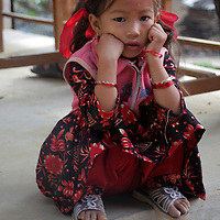 Asia, Nepal, Kathmandu, Kirtipur. Young girl sitting on step in village of Kirtipur.