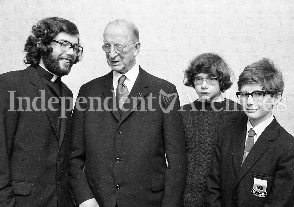 Mr Eamon DeValera with three of his grandsons following a special mass to celebrate his 91st Birthday, from(L) Father Sean O'Cuiv, who celebrated the mass and the Mass servers Ruairi O'Cuiv and Eoin O'Cuiv, 14/10/1973 (Part of the Independent Newspapers Ireland/NLI Collection).