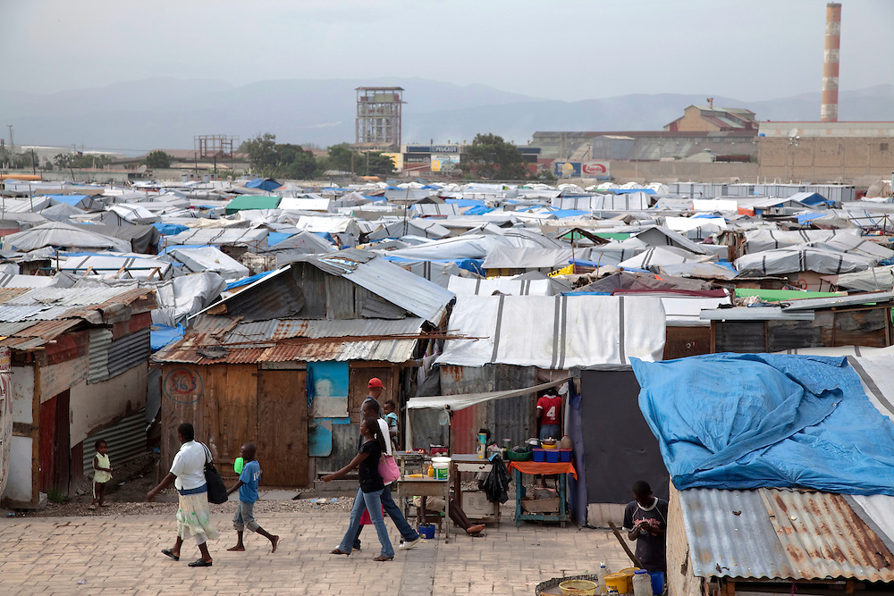 An overview of the makeshift refugee camp, La Piste, in Port-au-Prince, Haiti on July 15, 2010. <br /> <br /> La Piste (French for &quot;runway&quot;)is a settlement sprawled across the site of a disused airport and now home to an estimated 20,000 earthquake survivors living in makeshift structures.<br /> Six month after a catastrophic earthquake measuring 7.3 on the Richter scale hit Haiti on January 13, 2010, killing an estimated 230,000 people, injuring an estimated 300,000 and making homeless an estimated 1,000,000.