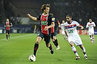 FOOTBALL - FRENCH CUP 2011/2012 - 1/4 FINAL - PARIS SAINT GERMAIN v OLYMPIQUE LYONNAIS - 21/03/2012 - PHOTO JEAN MARIE HERVIO / REGAMEDIA / DPPI - DIEGO LUGANO (PSG) / LISANDRO LOPEZ (OL)