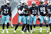 Tennessee Titans free safety Kevin Byard (31) celebrates with teammates after intercepting a first quarter pass and running it back 33 yards to the Baltimore Ravens 46 yard line during the 2017 NFL week 9 regular season football game against the Baltimore Ravens, Sunday, Nov. 5, 2017 in Nashville, Tenn. The Titans won the game 23-20. (©Paul Anthony Spinelli)