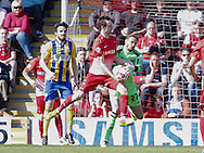 David Mooney of Leyton Orient and goalkeeper David Button of Brentford during the Sky Bet League 1 match at the Matchroom Stadium, London<br /> Picture by Mark D Fuller/Focus Images Ltd +44 7774 216216<br /> 15/03/2014