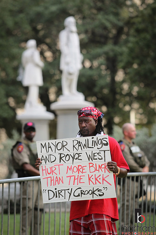 Police suround the Confederate War Memorial at Pioneer Park  Cemetery before an anti white-supremacy rally at Dallas City Hall plaza on Saturday, Aug. 19, 2017. (Photo by Kevin Bartram)