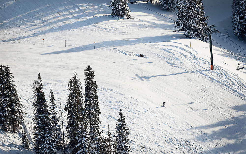 Eager skiers are seen going down a run in an aerial shot above Brighton Ski Resort on opening day for the resort, Tuesday, Nov. 13, 2012.