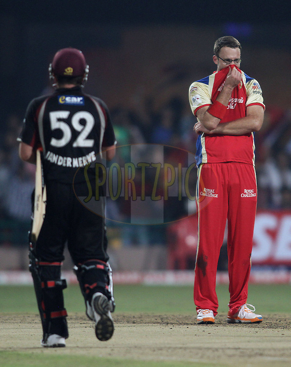 Royal Challengers Bangalore captain Daniel Vettori gets Roelof van der Merwe of Somerset wicket during match 16 of the NOKIA Champions League T20 ( CLT20 ) between the Royal Challengers Bangalore and Somerset held at the  M.Chinnaswamy Stadium in Bangalore , Karnataka, India on the 3rd October 2011..Photo by Shaun Roy/BCCI/SPORTZPICS