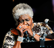 "(Jackson-Mississippi) Grammy award winner for  the song "" Misty Blue""and Jackson Mississippi native Dorothy Moore, singsand plays the harmonica, a rare treat, during her performance of her hit ""Misty Blue"" at the first annual Southern Crossroads Music &Tamale Festival Saturday August 11,2012. She was also presented by a proclamation from the mayor of Jackson. Photo © Suzi Altman."