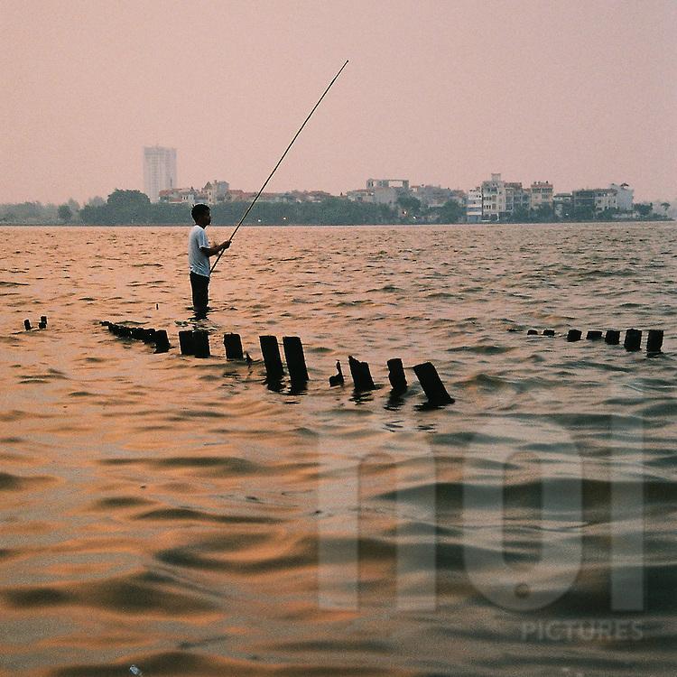 Fisherman on Tay Ho (west lake) by sunset.Hanoi