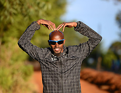 © Licensed to London News Pictures. Iten, Kenya. MO FARAH doing the 'Mobot' as he poses for a photograph. Double world and Olympic champion MO FARAH in training at an altitude training camp based at 2,500m in Iten, Kenya, ahead of the 2014 Virgin Money London Marathon in April this year. The Somalia born, adopted Brit, is looking to make the jump from the 10,000m distance to a full marathon for the first time in front of a home crowd. Photo credit : Mike King/LNP