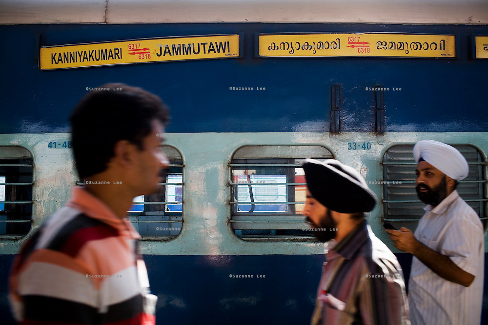 Passengers disembark as the Himsagar Express 6317 pulls in to the Jammu Tawi station after its four day journey from Kanyakumari on 6th July 2009.. .6318 / Himsagar Express, India's longest single train journey, spanning over 3720 kms, going from the mountains (Hima) to the seas (Sagar), from Jammu and Kashmir state in the Indian Himalayas to Kanyakumari, the southern-most tip of India..Photo by Suzanne Lee / for The National.