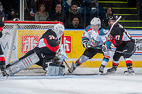 KELOWNA, CANADA -FEBRUARY 25: Rourke Chartier #14 of the Kelowna Rockets tries to score a goal on the net of Ty Edmonds #35 as Joseph Carvalho of the Prince George Cougars checks him from behind during first period on February 25, 2014 at Prospera Place in Kelowna, British Columbia, Canada.   (Photo by Marissa Baecker/Getty Images)  *** Local Caption *** Rourke Chartier; Ty Edmonds; Joseph Carvalho;