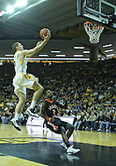 December 04 2010: Iowa Hawkeyes guard Matt Gatens (5) puts up a shot over Idaho State Bengals guard Broderick Gilchrest (2) during the first half of their NCAA basketball game at Carver-Hawkeye Arena in Iowa City, Iowa on December 4, 2010. Iowa won 70-53.