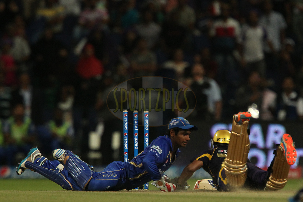 Sanju Samson of the Rajatshan Royals runs out Shakib Al Hasan of the Kolkata Knight Riders during the SUPER over in match 19 of the Pepsi Indian Premier League 2014 Season between The Kolkata Knight Riders and the Rajasthan Royals held at the Sheikh Zayed Stadium, Abu Dhabi, United Arab Emirates on the 29th April 2014<br /> <br /> Photo by Ron Gaunt / IPL / SPORTZPICS