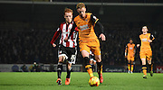 Sam Clucas and Ryan Wood battle for posession during the Sky Bet Championship match between Brentford and Hull City at Griffin Park, London, England on 3 November 2015. Photo by Michael Hulf.