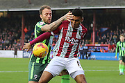 Sean Rigg of AFC Wimbledon and Jamie Reid of Exeter City tussles during the Sky Bet League 2 match between Exeter City and AFC Wimbledon at St James' Park, Exeter, England on 28 December 2015. Photo by Stuart Butcher.