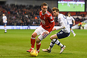 Nottingham Forest midfielder Barry McKay (10) battles with Preston North End striker Tom Barkhuizen (29) during the EFL Sky Bet Championship match between Nottingham Forest and Preston North End at the City Ground, Nottingham, England on 30 January 2018. Photo by Jon Hobley.