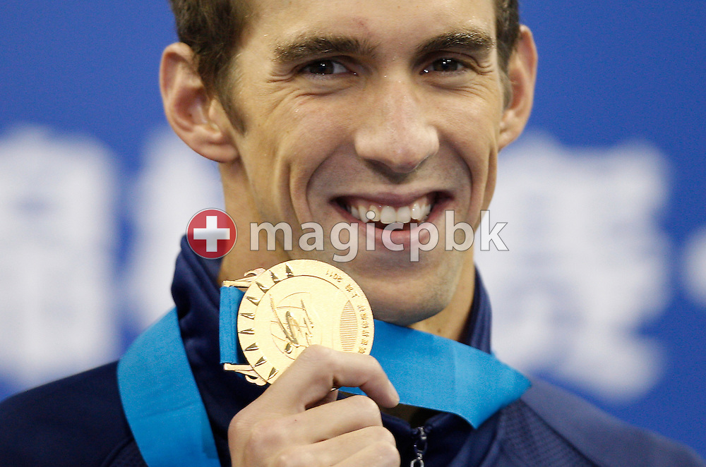 Michael PHELPS of United States of America (USA) poses with his gold medal during the award ceremony after winning the men's 100m Butterfly Final during the 14th FINA World Aquatics Championships at the Oriental Sports Center in Shanghai, China, Saturday, July 30, 2011. (Photo by Patrick B. Kraemer / MAGICPBK)