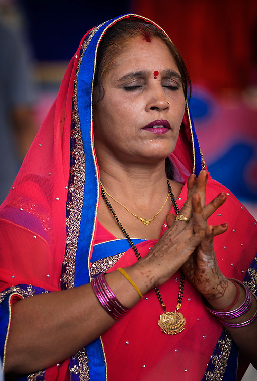 A  woman prays at the 6th Ganesha Festival at Utthyan Ganesha Temple, Thailand.