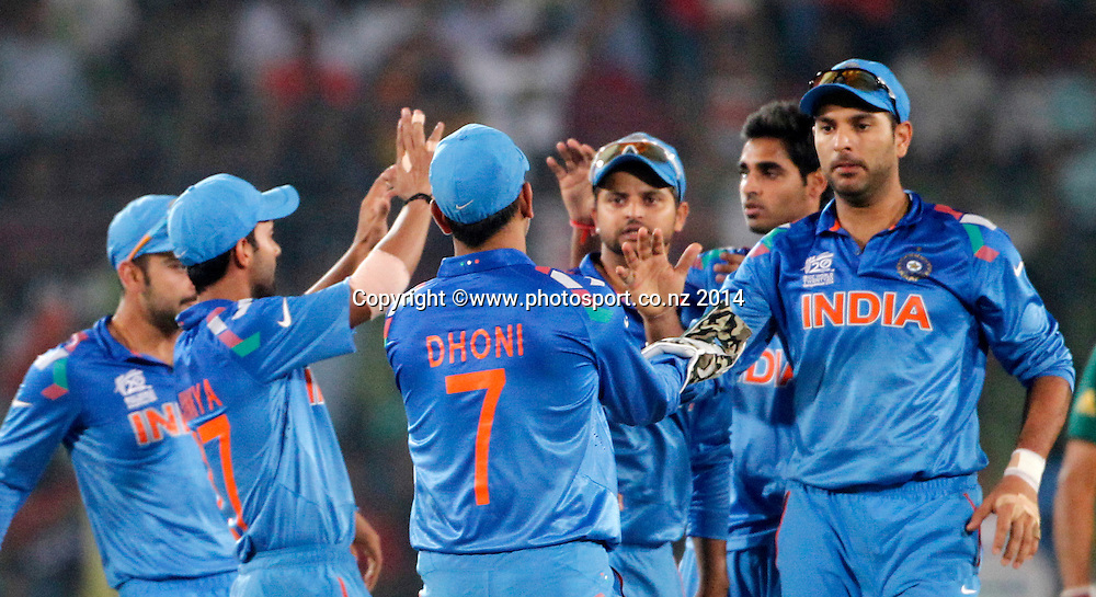 India team celebrate Quinton de Kock's wicket. ICC Twenty20 World Cup, Semi Final 2, India v South Africa at Sher-e-Bangla National Cricket Stadium, Mirpur, Bangladesh. 4 April 2014. Photo: www.photosport.co.nz