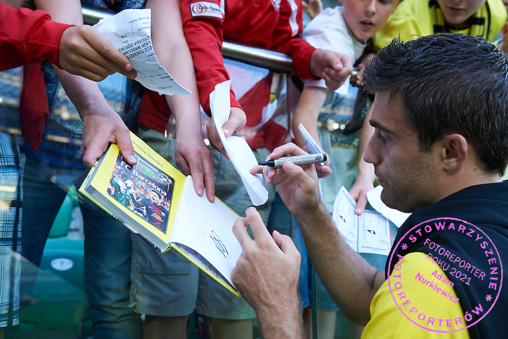 Sokratis Papastathopoulos of Dorussia Dortmund signs his autograph for Dorussia Dortmund's supporters after international friendly soccer match between WKS Slask Wroclaw and BVB Borussia Dortmund on Municipal Stadium in Wroclaw, Poland.<br /> <br /> Poland, Wroclaw, August 6, 2014<br /> <br /> Picture also available in RAW (NEF) or TIFF format on special request.<br /> <br /> For editorial use only. Any commercial or promotional use requires permission.<br /> <br /> Mandatory credit:<br /> Photo by &copy; Adam Nurkiewicz / Mediasport