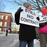 12/11/09 -- BATH, Maine. Louise LaMarque, left, English teacher,   chats with school nurse Sharon Morrill outside Morse High School during a protest on Friday morning . About 15 teachers protested the lack of a contract after a four-month delay in 25-degree weather as students walked in for classes.  Photo by Roger S. Duncan.