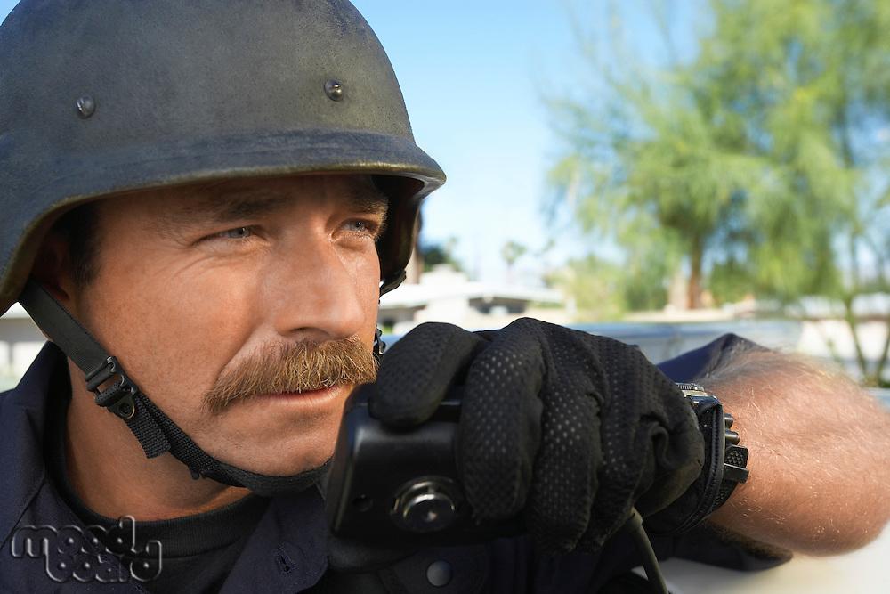 Swat officer using walkie-talkie